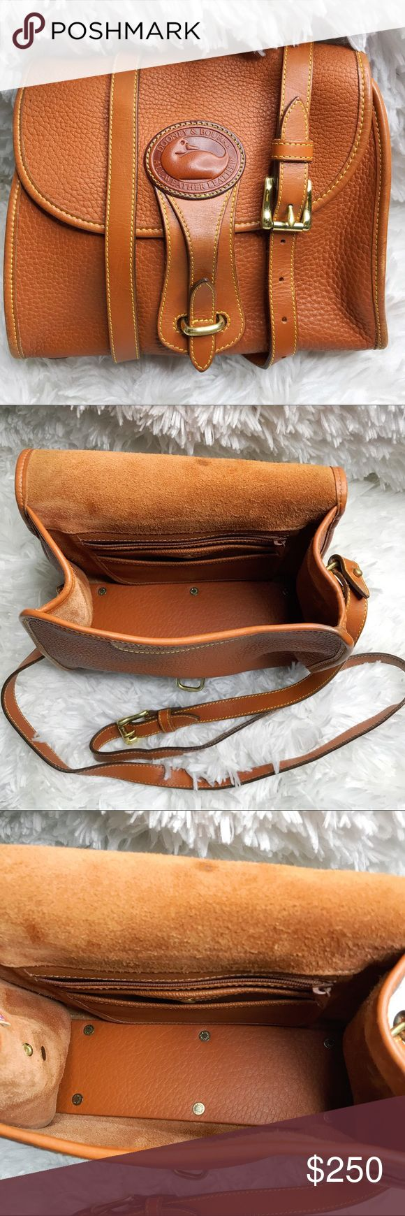 Dooney & Burke Vintage Medium Essex Crossbody Bag Bag is authentic.   Color: English Tan Measurements: 10 x 8 x 3.5 inches Vintage bag has 6 brass bag protectors on the bottom.  Bag is in excellent vintage condition.  Some wear on corners as would be a expected.  It does have a few marks which are not that easy to spot see pictures. Dooney & Bourke Bags Crossbody Bags