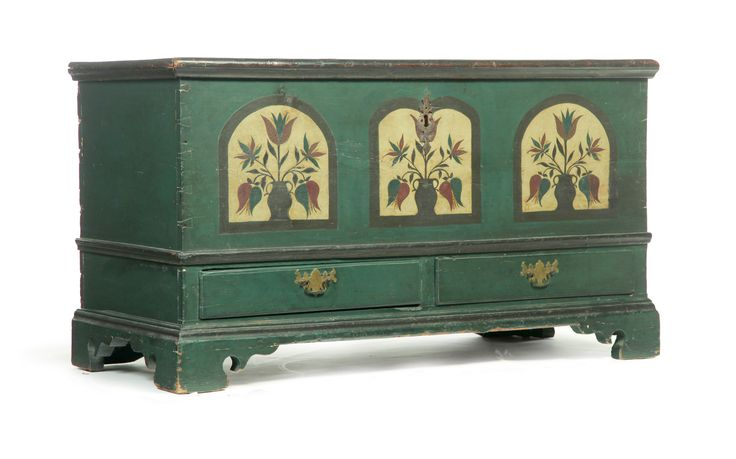 """DECORATED PENNSYLVANIA CHIPPENDALE BLANKET CHEST.  Late 18th century, pine. Dovetailed case with two drawers and bracket feet. Appears to retain its original blue-green paint with faux tombstone panels with urns of tulips. Imperfections. 29""""h. 52""""w. 23""""d."""