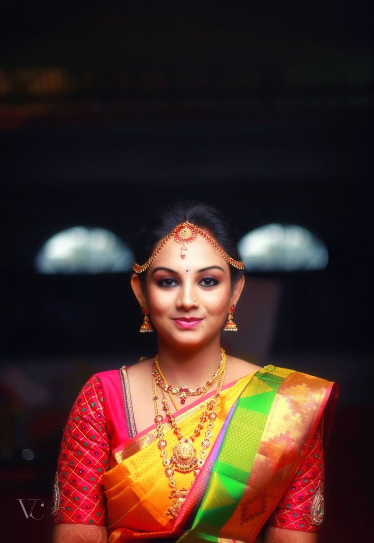 South Indian bride. Gold Indian bridal jewelry.Temple jewelry. Jhumkis. Pink and yellow silk kanchipuram sari.Braid with fresh jasmine flowers. Tamil bride. Telugu bride. Kannada bride. Hindu bride. Malayalee bride.Kerala bride.South Indian wedding.