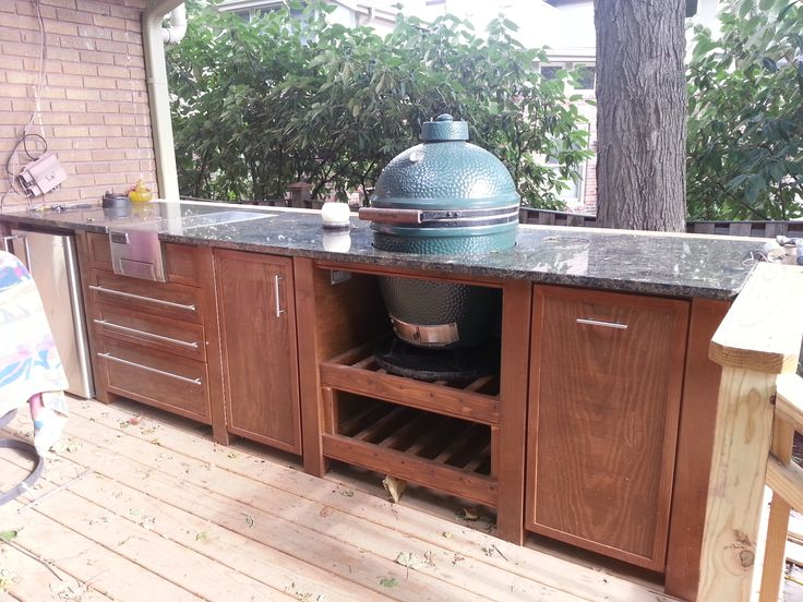 Custom outdoor bar with Green Egg grill by Ronald J Frazee Designer