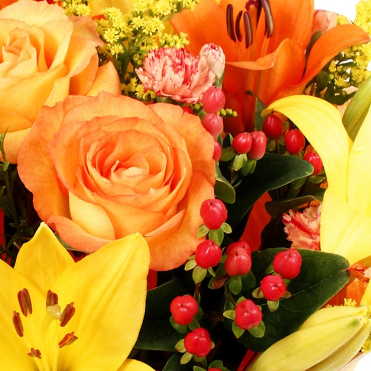 This beautiful bouquet of flowers has autumn shades of yellow, red and orange.  http://www.eden4flowers.co.uk