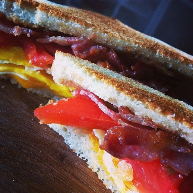 Post-workout #brunch: bacon, fried egg, cheddar and tomato sandwich. #cdncheese #simplepleasures #nomnomnom