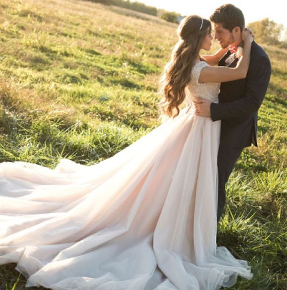 Jessa Duggar married Ben Seewald in a church wedding ceremony in Bentonville, Arkansas. The bride wore a Swarovski crystal wedding dress by Allure Bridal.