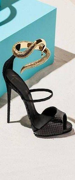 Giuseppe Zanotti ~ Colette Le Mason @}-,-;--- No one makes shoes like Guiseppe! Unique Black sandals always win