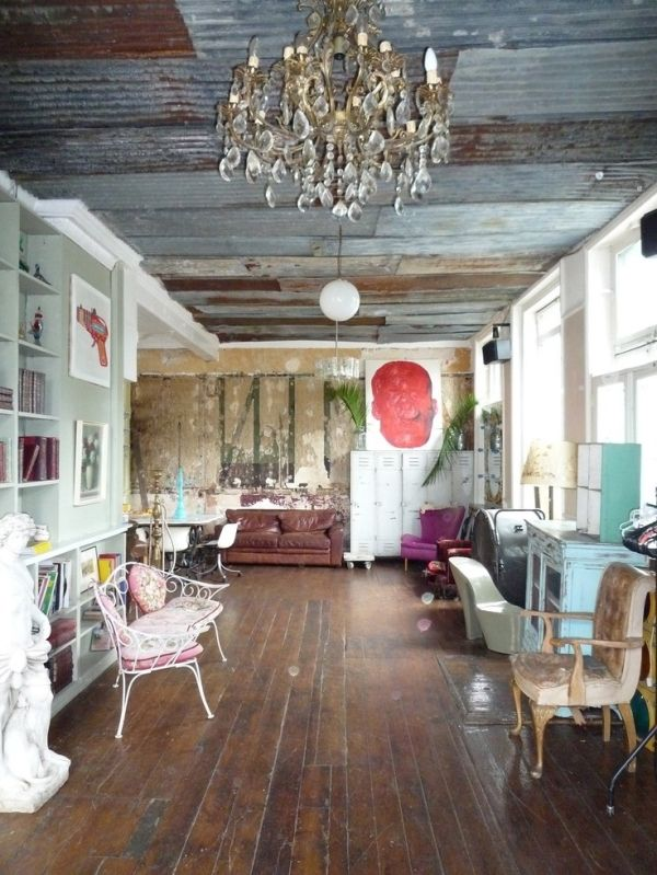i love the combination of the old corrugated tin ceiling and the crystal chandelier - Tin Ceilings