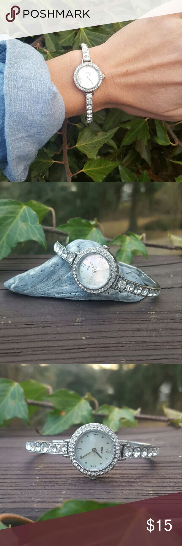 Relic watch never been worn Super cute Relic watch I got a few years ago and literally never wore but the battery did die, so it does need a new one. Stainless steel back (with protective sticker still on). Water resistant for up to 50 meters. Relic Accessories Watches
