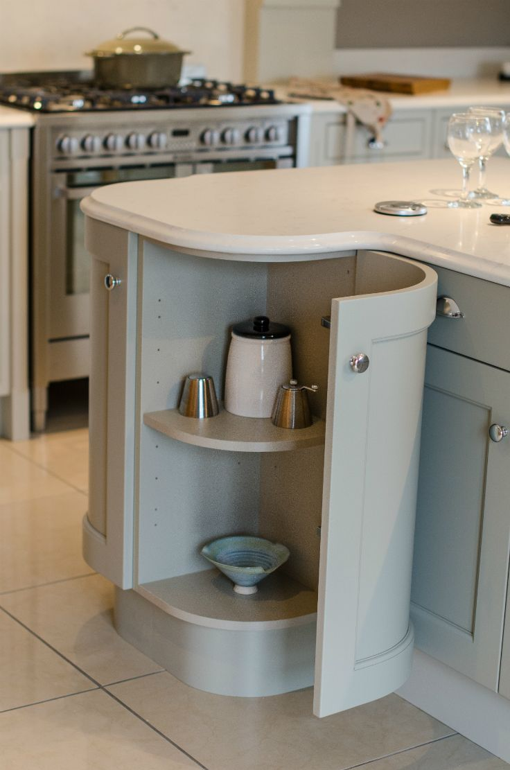 A curved door unit in an inframe kitchen at Newhaven Kitchens.