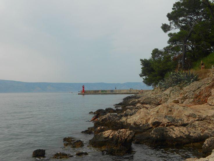 Rocky beach and lighthouse in Jelsa (Hvar)