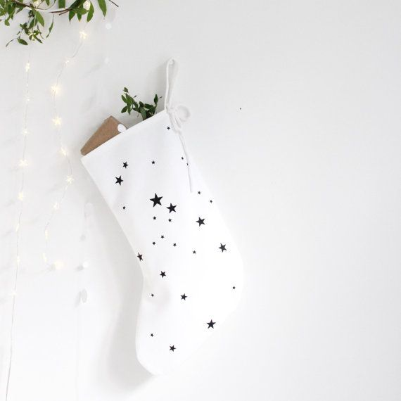 * monochrome christmas stocking, white stocking, white christmas, black star print, medium christmas stocking, minimal christmas decor *  This stocking is medium sized [other sizes are available]. It is a lined white cotton canvas and comes hand printed with a cluster of inky black stars.  Stocking measures approx 9/23cm [heel to toe] x 14/35cm [h] and is cut, stitched, printed and pressed to order. It is made from a lovely heavyweight cotton fabric and finished with a good sized hanging…