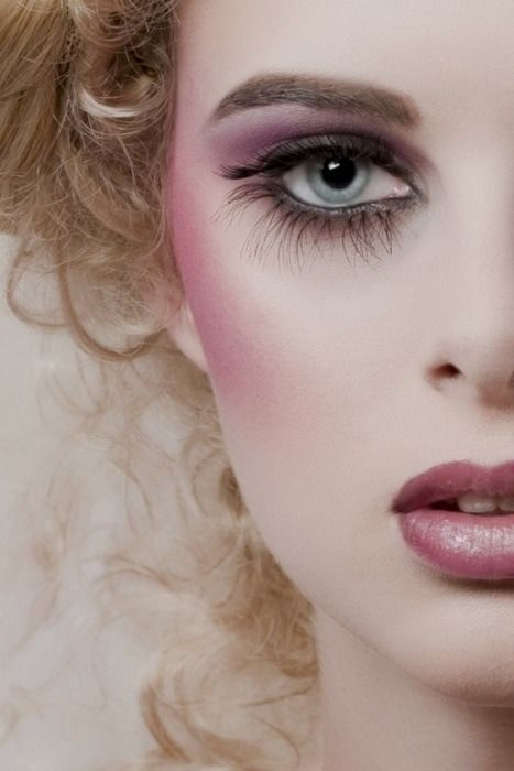 This is a perfect face. A simple but attractive way to wear makeup. A pale face with rosy blush and perfect lips.
