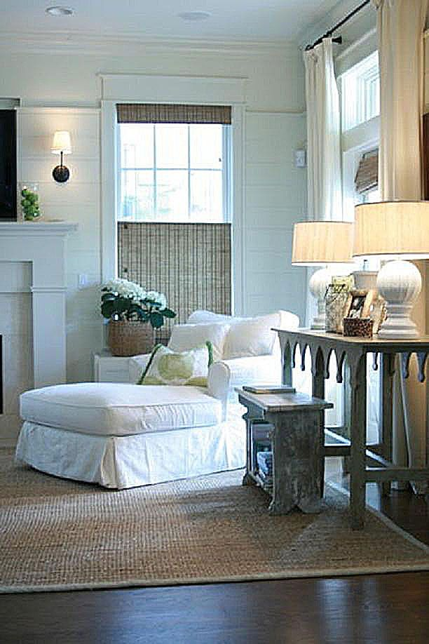GRANDMA BEDROOM LOUNGE CHAIR A Cozy Reading Corner With Top Down Woven Wood  Shades, A Chaise Lounge In White Slipcover Textured Rug And Soft Lamp  Lighting.