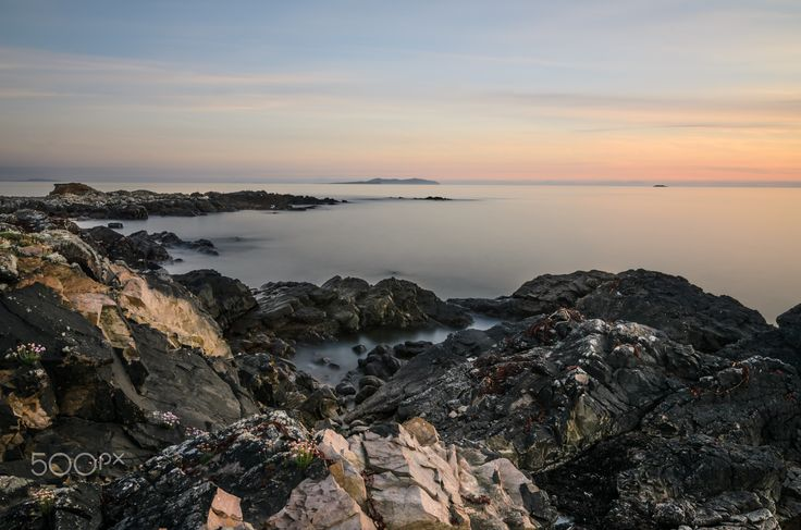"""Silk and Shards - From Roonagh Pier, Mayo, Ireland along the Wild Atlantic Way. A soft gentle sunset against the harsh rock that has been battered by the Atlantic. Stay in touch: <a href=""""https://www.facebook.com/kathrynconwayphotography"""">Facebook Page</a>, <a href=""""https://instagram.com/conwaykathryn/"""">Instagram</a> or <a href=""""https://twitter.com/kcgrasshopper/"""">Twitter</a>"""