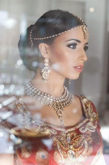 Breathtakingly beautiful. Love the simple headpiece.   Via Beautiful Indian Brides  Makeup by:Shafika Sodawala