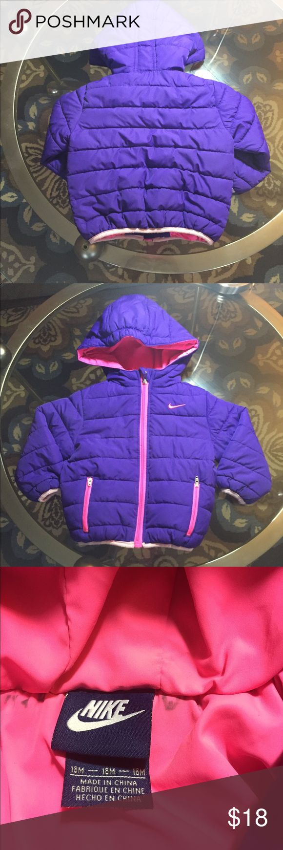 Girl's Nike Coat Light weight purple and pink Nike coat. Good Used Condition... name was written on the inside lining of the coat but has been blacked out. ✨REASONABLE offers welcome✨  ✨Bundle and Save✨ Nike Jackets & Coats Puffers