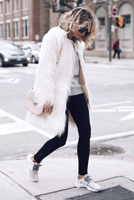 fall / winter - street style - street chic style - winter outfits - casual outfits - white fur coat + grey sweater + black leggings + cream sneakers + pale pink shoulder bag + black sunglasses - athleisure - comfy outfits