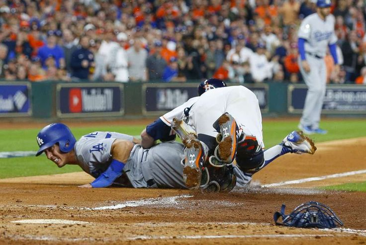 October 28, 2017:  Game 4 of World Series.  Los Angeles Dodgers and Houston Astros, 6 to 2, Dodgers. Houston Astros catcher Brian McCann (16) tags Los Angeles Dodgers catcher Austin Barnes (15) during the sixth inning of Game 4 of the World Series at Minute Maid Park on Saturday, Oct. 28, 2017, in Houston. Photo: Brett Coomer/Houston Chronicle