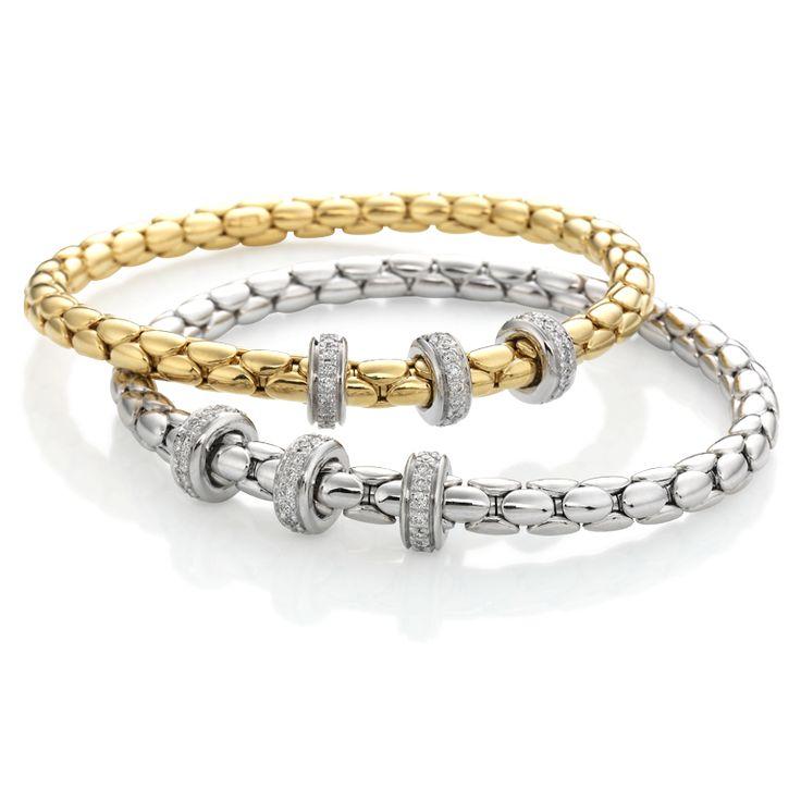 CHIMENTO Stretch Spring gold bracelets with diamonds.