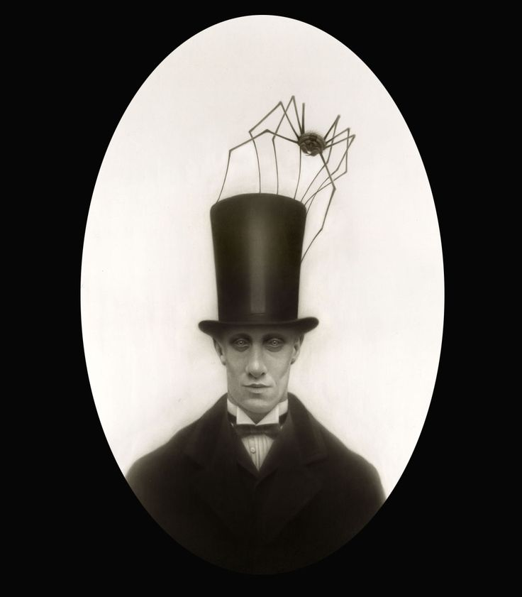"Travis Louie: ""Herman found his prized huntsman spider in the basement of his parents' house. Although it was common to have large insects as pets in this town, it was frowned upon to have an arachnid as a pet.  When they would go for a stroll or take in a show at the theatre, Morris would hide in Herman's stovepipe hat and watch through tiny holes near the top of the hat band. Herman could even hear him clapping at the close of the each performance. It made him laugh out loud every time."""