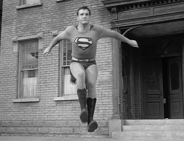 """Reeves' Superman's landings in """"Adventures of Superman"""" were accomplished by installing a pull-up bar just before Superman touched down. Description from whatculture.com. I searched for this on bing.com/images"""