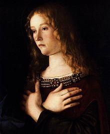 Madonna col Bambino tra le sante Caterina e Maria Maddalena -  rivolta verso il Bambino, con le mani incrociate sul petto.Giovanni Bellini