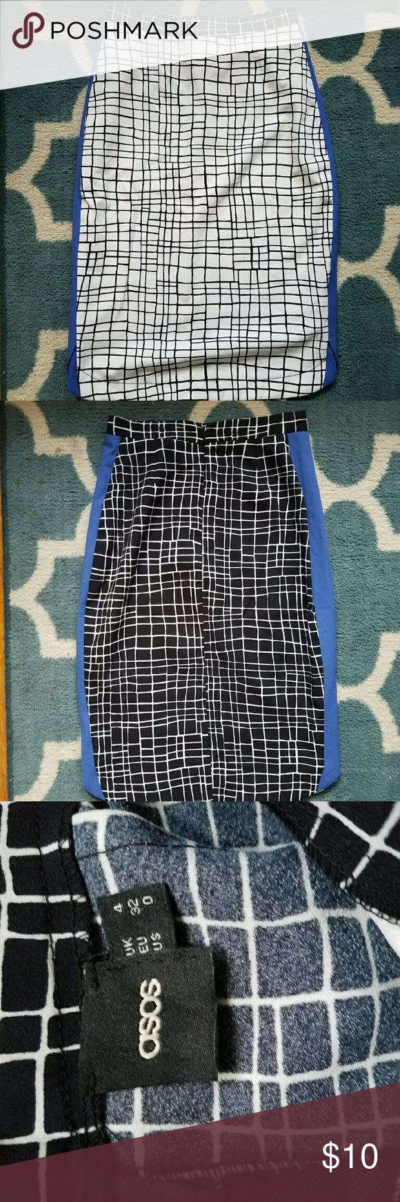 ASOS Grid Pencil Skirt This pencil skirt is from ASOS. The front has a white background with black lines and the back had a black background with white lines. There are blue panels on the side. This skirt is in good condition and has only been worn a couple times. ASOS Skirts Pencil