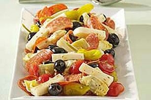 Antipasto: summer sausage, provolone, pepperoncini, olives, canned mushrooms, artichoke hearts, cherry tomatoes, Italian dressing