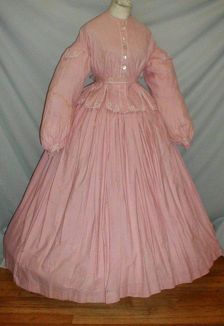 Museum de-accessioned mid-60s dress. A delightful 1860's pink cotton print dress that has been de-accessioned from a museum collec...