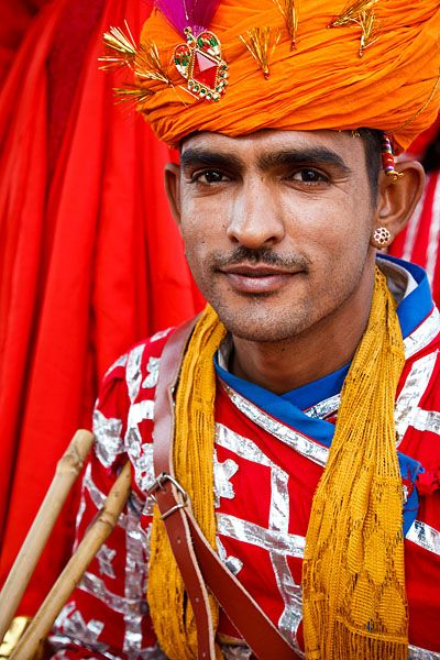 Portrait of a male performer in traditional Rajasthani dress, during the annual Elephant Festival, held every March in the Pink City of Jaipur.