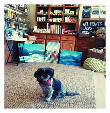 Ira Mitchell's photo. Rosie in store with my metal paintings For Sale www.artbyira.net