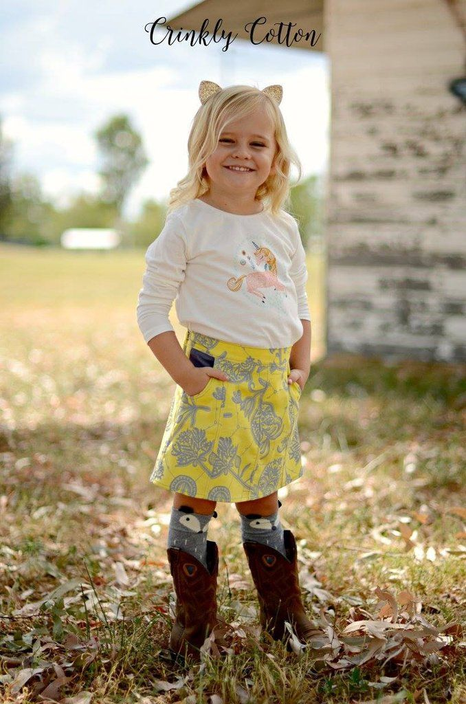 PDF Pattern: Girls Lovebug A-line Skirt sewing pattern. Shown here in knee length with pockets.
