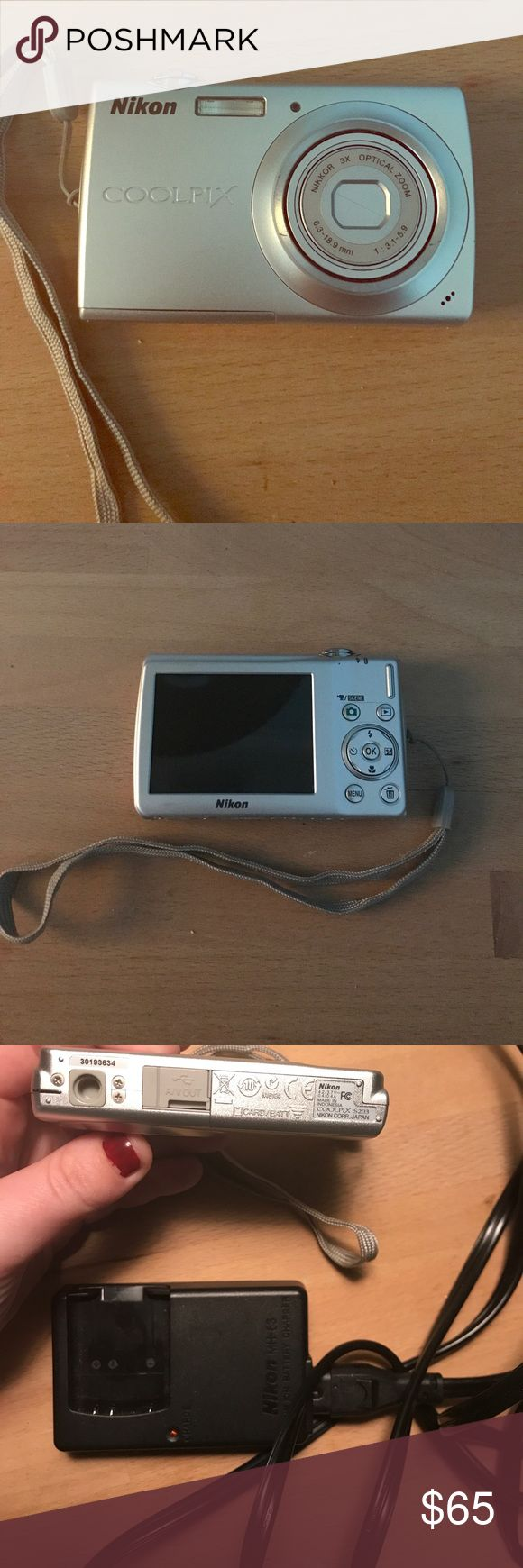Nikon Coolpix camera No scratches on screen, used but still good condition, comes with battery, battery charger, and camera case but does not come with SD card for pictures Nikon Other