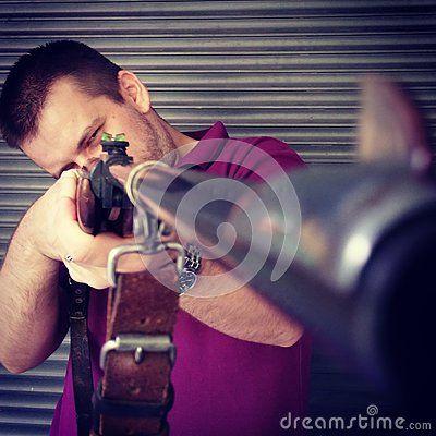 Stock Photo about Man holding a vintage shotgun