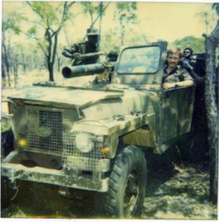 October 3rd, 1987. Soviet officer Mischenko and Angolan soldiers travel to the front with a Land Rover captured from the enemy. Photograph taken somewhere in the vicinity of the Lomba River in Angola.
