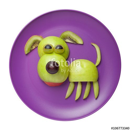 "Download the royalty-free photo ""Happy dog made of apple on purple plate"" created by serg78 at the lowest price on Fotolia.com. Browse our cheap image bank online to find the perfect stock photo for your marketing projects!"