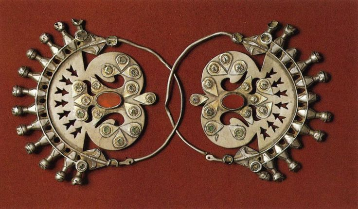 Gulak-khalkah earrings    The Yomud ethnic group, Turkmenia. Late 19th century. Silver, stamped and engraved, with cornelians.    The Museum of Oriental Art, Moscow
