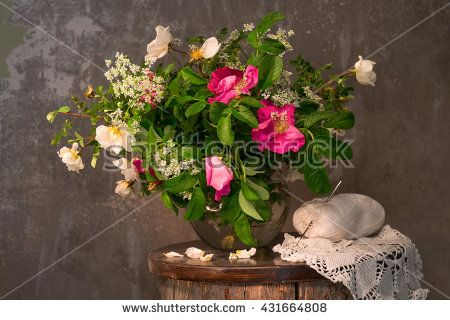 Still life with flowers and wild rose crochet doily