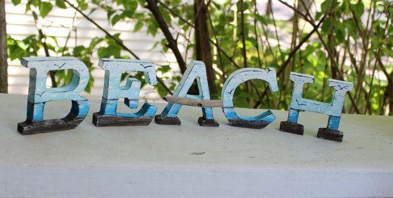 het strand! Dit is de ultieme kust decoratie. hand geschilderd in een kunst zee scape. De prachtige nautische letters zijn vrijstaande of u hardware voor een prachtige muur opknoping kan toevoegen.  Elke houten letter is geschilderd op de voorkant, zijkanten, en terug een volledig afgewerkte look.  De A heeft zijn versierd met een mooie surf tuimelde drijfhout stuk.  Neem nota van de metingen:  Afzonderlijke letters meten ca. 3 1/2 hoog X 3 1/2 Wide  U ontvangt het exacte B, E, A, C, H…