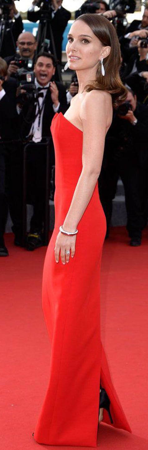 Natalie Portman in a red gown and statement earrings at the 68th Annual Cannes Film Festival / karen cox.