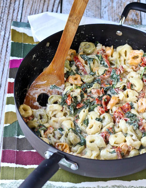 Tortellini with Creamy Sun-Dried Tomato Sauce and Spinach is a weeknight meal or a meal to impress guests! You'll love the flavor the sun-dried tomatoes add to the sauce!