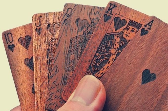 Step up your poker game with this beautiful deck of Wooden Playing Cards. These are the kind of cards you play with while sipping whiskey and smoking a cigar. Includes a...