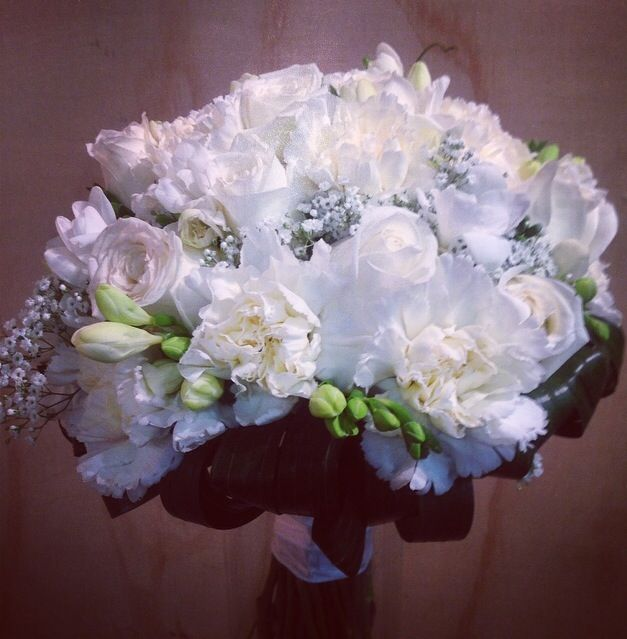 Little flower lane. Roses, freesia and carnations. Wedding bouquet bride.