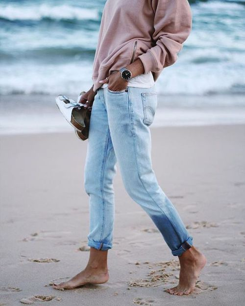 after wading in the water w/ birks in hand ( this whole outfit could honestly be recreated ) loose light wash jeans , watch, and dusty pink sweater