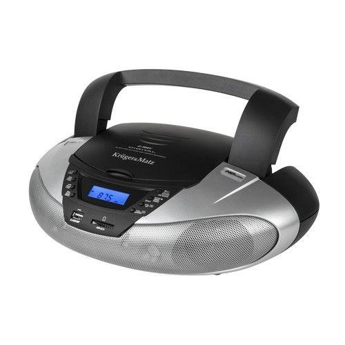 Krüger & Matz KM3902 Boombox met radio CD SD USB  De Krüger & Matz boombox radio / CD-speler is de perfecte oplossing voor diegene die geen behoefte heeft aan een ingewikkeld toestel om van hun favoriete muziek te genieten. Dit product is geschikt voor gebruik op vele plaatsen in huis; zoals in de keuken de slaapkamer of woonkamer. Dankzij een geïntegreerde handgreep kan dit product eenvoudig van de ene plaats naar de andere worden verplaatst. Het kleine formaat van het toestel en de…