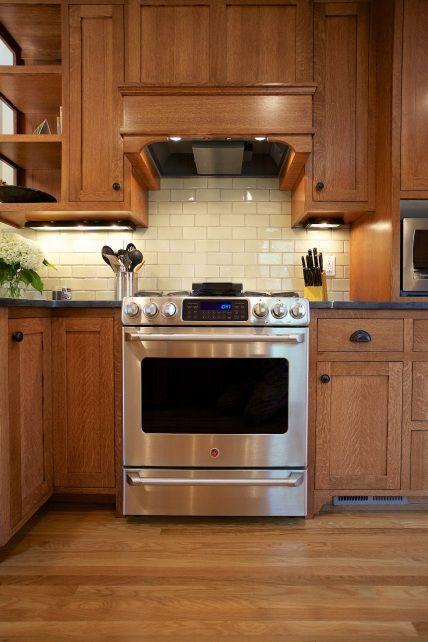 Quarter-sawn oak cabinetry, soapstone countertops, wood floors, and beautiful custom oak hood create a great updated, but traditional look.