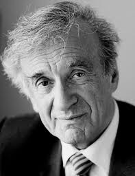 """Eliezer """"Elie"""" Wiesel was born September 30 1928 and is a Romanian-born Jewish-American writer, professor, political activist, Nobel Laureate, and Holocaust survivor. He is the author of 57 books, including """"Night,"""" a work based on his experiences as a prisoner in the Auschwitz, Buna, and Buchenwald concentration camps. Wiesel is also the Advisory Board chairman of the newspaper Algemeiner Journal."""