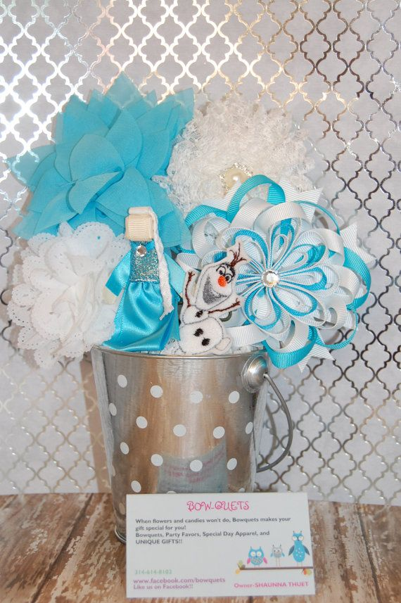 Frozen Inspired Bowquet by Bowquetsandbirthdays on Etsy, $35.00 Each BOW-quet comes with 6 hair clips arranged like a bouquet of flowers and a headband that all clips can be attached to or worn alone. Never have a boring gift for the special little girl in your life. What's better...no one is allegic to pretty! I do most themes. All proceeds goes towards medical expenses for my twins. They are Twin to Twin SURVIVORS Visit www.facebook.com/bowquets for more info.
