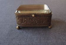 ANTIQUE BEVELED GLASS TOP DECORATED WITH SCROLLS GOLDEN METAL JEWELRY BOX