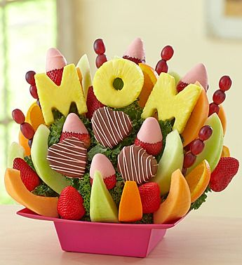 Mom's the Best (fruit bouquet). Wonder if a name could be used instead. I would use a heart shape in place of the letter O, or even a gift card on a pick.