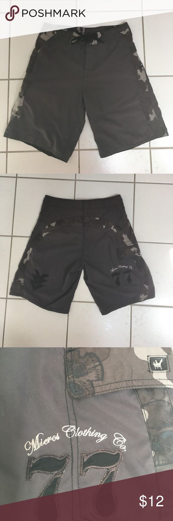 Men's swim board shorts size 32 camp grey - used Micros Men's board shorts. Size 32.  Grey with camo design stripe across back & down backside.  Velcro pocket on left & front Velcro & tie closure.  Used - still very nice Micros Swim Board Shorts