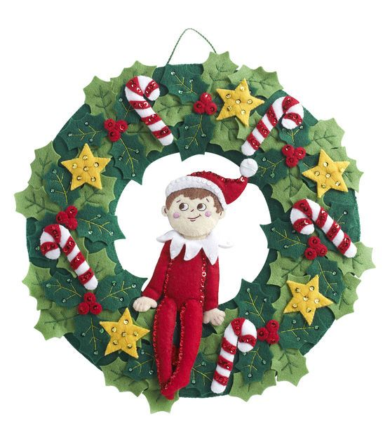 Bucilla-Elf On The Shelf Wreath Felt Applique Kit. Festive designs, quality materials and generous embellishments continue to make Bucilla felt kits a favorite stitchery tradition. This package contai